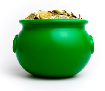 A green cauldron style pot full of gold coins