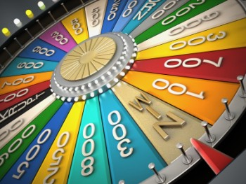 A brightly coloured (wheel of chance style) wheel with the wheel having stopped  on the win slot