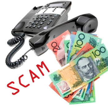 A black phone with the word Scam written in red and a pile of Australian money next to it.