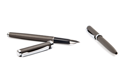 Two fountain pens on a white background