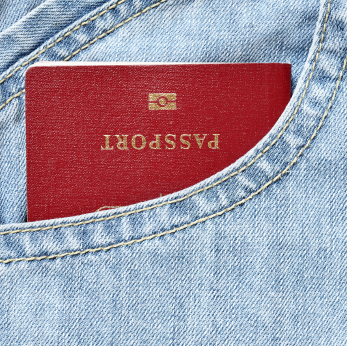 A red passport in a denim pocket