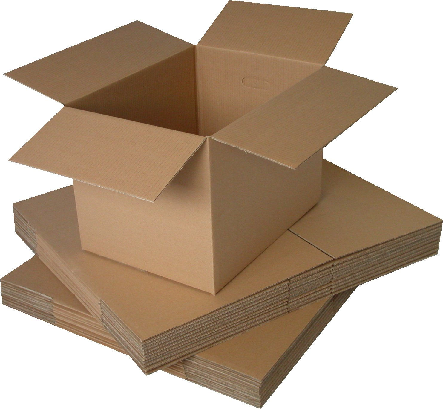 A pile of cardboard boxes flat packed with an open cardboard box on the top