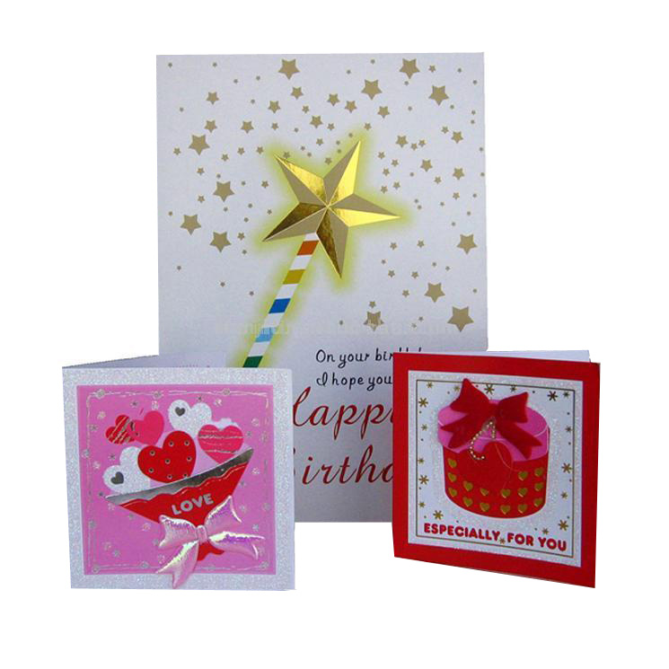 Three greeting cards one with an image of a wand on it , one with a picture of a pink present and the last one with a bunch of love hearts.