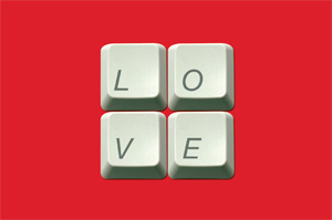 The word love spelled out on computer keys on a red background.