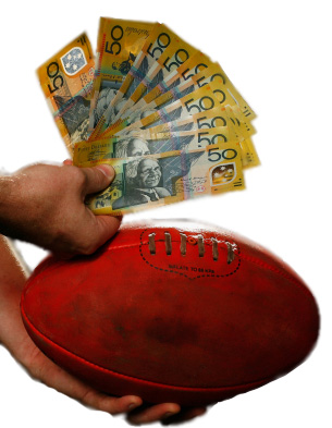 A hand holding a dirty red football and a large number of Australian $50 notes on a whitebackground
