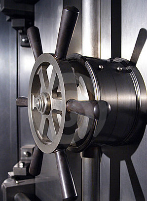 A large wheel lock on a bank vault