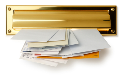 a gold letter slot with mail sticking through it on a white background